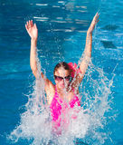 Girl in a pool Royalty Free Stock Photography