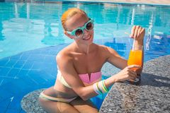 Girl in pool bar Royalty Free Stock Images