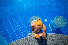 Girl in pool bar Royalty Free Stock Photography