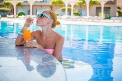 Girl in pool bar Stock Photography