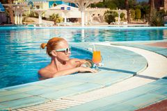 Girl in pool bar Royalty Free Stock Photo