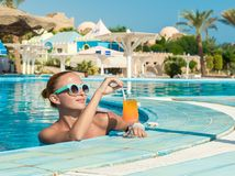 Girl in pool bar Royalty Free Stock Image