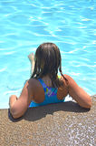 Girl in the pool. Stock Photos