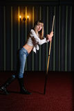 Girl with a pool cue Royalty Free Stock Images
