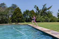 Girl Pool Jumping Stock Photo