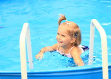 Girl in pool Stock Photography