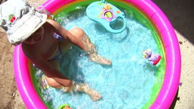 Girl in the pool 02 stock video footage