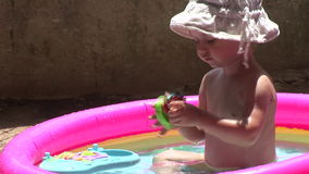 Girl in the pool 01 stock video footage