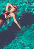 Girl in pool Royalty Free Stock Image