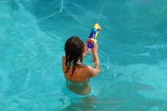 The girl in pool plays with a children's toy Royalty Free Stock Images