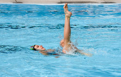 Girl in a pool practicing synchronized swimming Royalty Free Stock Photo