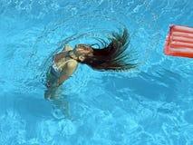 Girl in the pool stock image