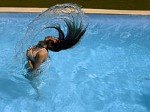 Girl in the pool. Girl shaking her hair in the pool Stock Photo