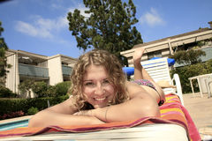 Girl at pool stock photography