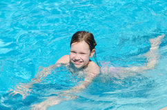 Girl in the pool Stock Photography