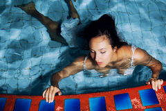 The girl at the pool Royalty Free Stock Photo