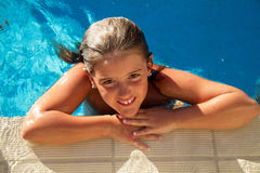 Girl in pool Stock Photos