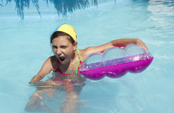 Girl in pool. Young girl swims play in pool Stock Photography