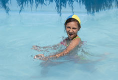 Girl in pool. Young girl swims play in pool Stock Images