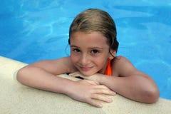 Girl at pools edge. Pretty young girl at pool's edge Stock Photos
