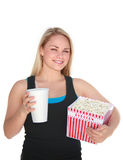 Girl with Popcorn. Cute young blonde woman holding large box of popcorn and a coke Royalty Free Stock Photography