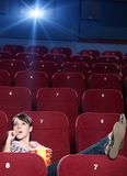 A girl with popcorn at the cinema stock photos