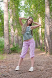 Girl in poplar forest Royalty Free Stock Photography