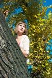 Girl on a poplar Stock Photo