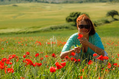 Girl in poppies Stock Photos