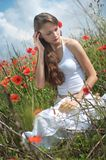 Girl in poppies Royalty Free Stock Photos