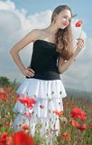 Girl in poppies Stock Image