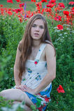 Girl and Poppies Stock Photos