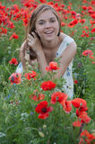 Girl and Poppies Royalty Free Stock Images