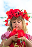 Girl with poppies. Little girl's portrait in poppies Royalty Free Stock Image