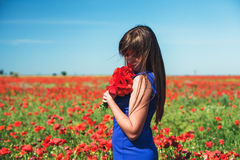 Girl with poppies Stock Photography