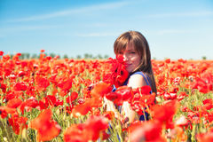 Girl with poppies Stock Photo
