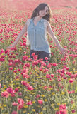 Girl in poppies Stock Photography