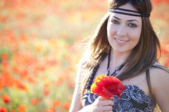 Girl with poppies bunch Royalty Free Stock Photo