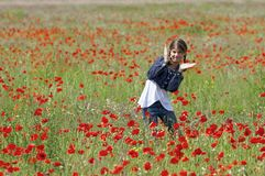 Girl with poppies dancing Stock Photos