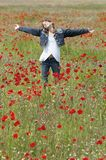Girl with poppies enjoy vertical Royalty Free Stock Photo