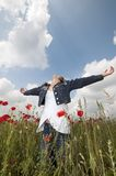 Girl with poppies enjoy wide Stock Photos