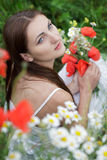 Girl in poppies field Royalty Free Stock Photos