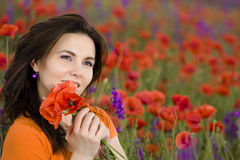 Girl on a poppies field Royalty Free Stock Photography