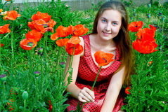 Girl in poppies field Royalty Free Stock Photo
