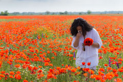 Girl in poppies field Stock Photo