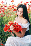 Girl in poppies field Stock Image