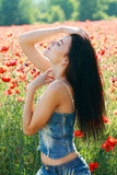 Girl in poppies field Stock Photos