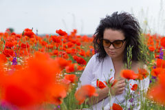 Girl in poppies field Royalty Free Stock Photography