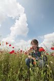 Girl with poppies funny face Royalty Free Stock Images