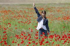 Girl with poppies happy Royalty Free Stock Images